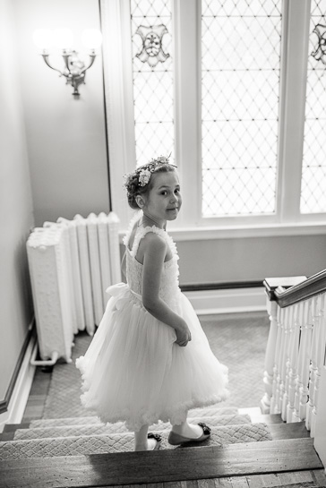 Flower girl descends stairs at Grant-Humpreys wedding