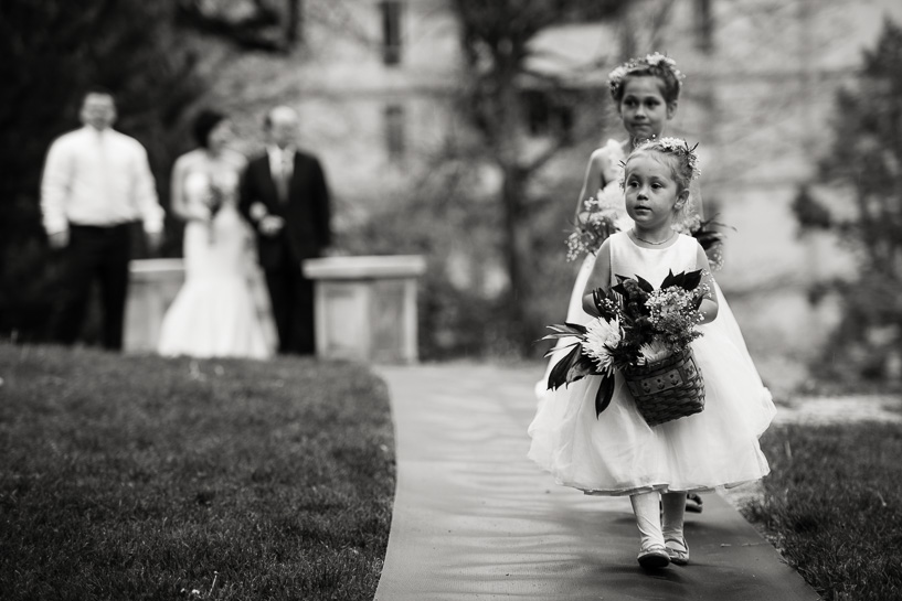 Flower girl procession by Denver wedding photojournalist.