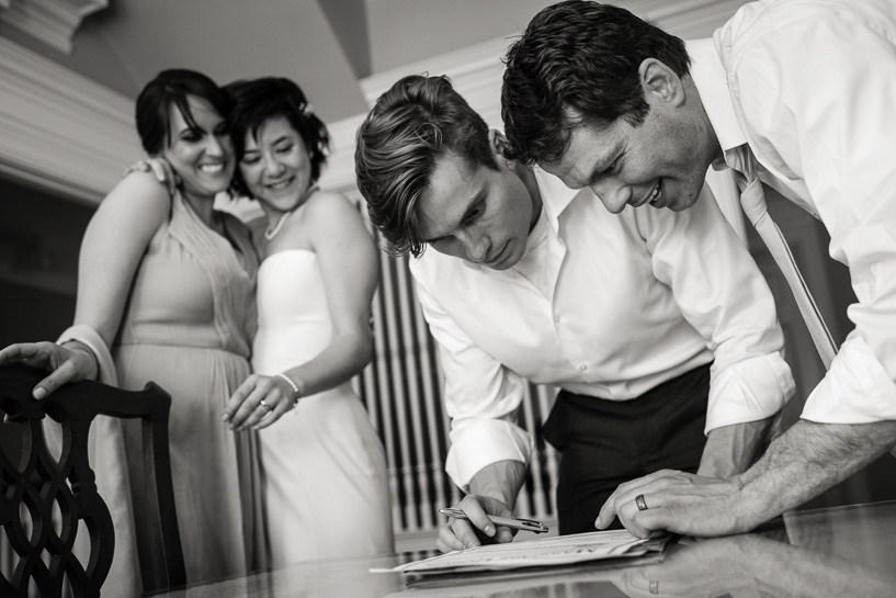 Marriage license signing by Denver wedding photojournalist