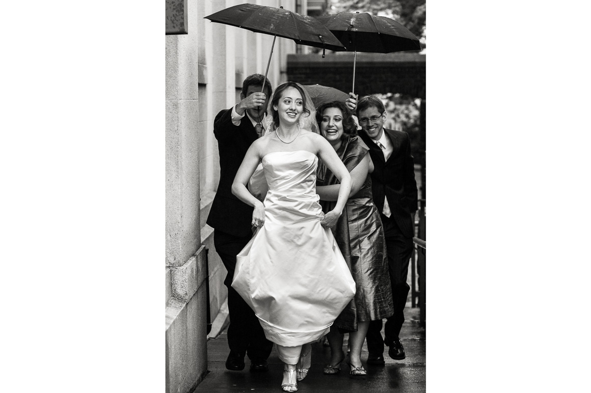 Ushers Escourt Bride with Umbrellas Assorted Moments Carl Bower Wedding Photographer