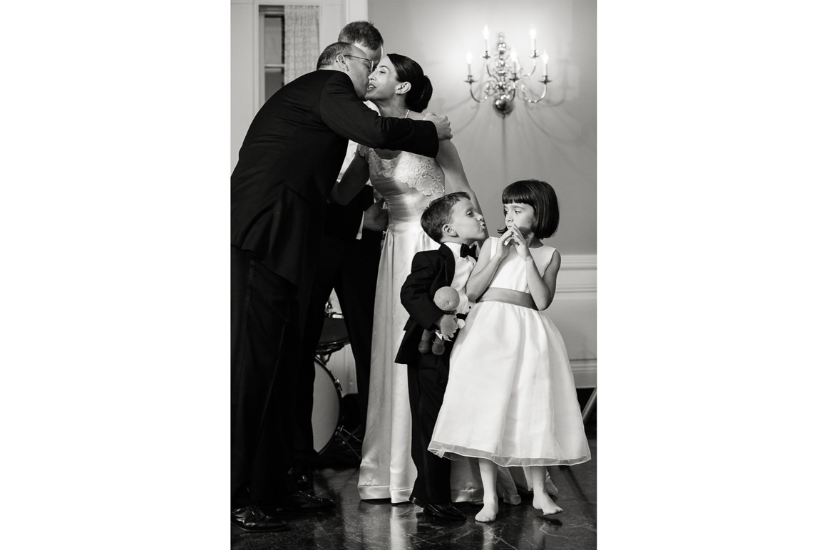 Girl Evading Kiss from Boy assorted moments Denver wedding photojournalist