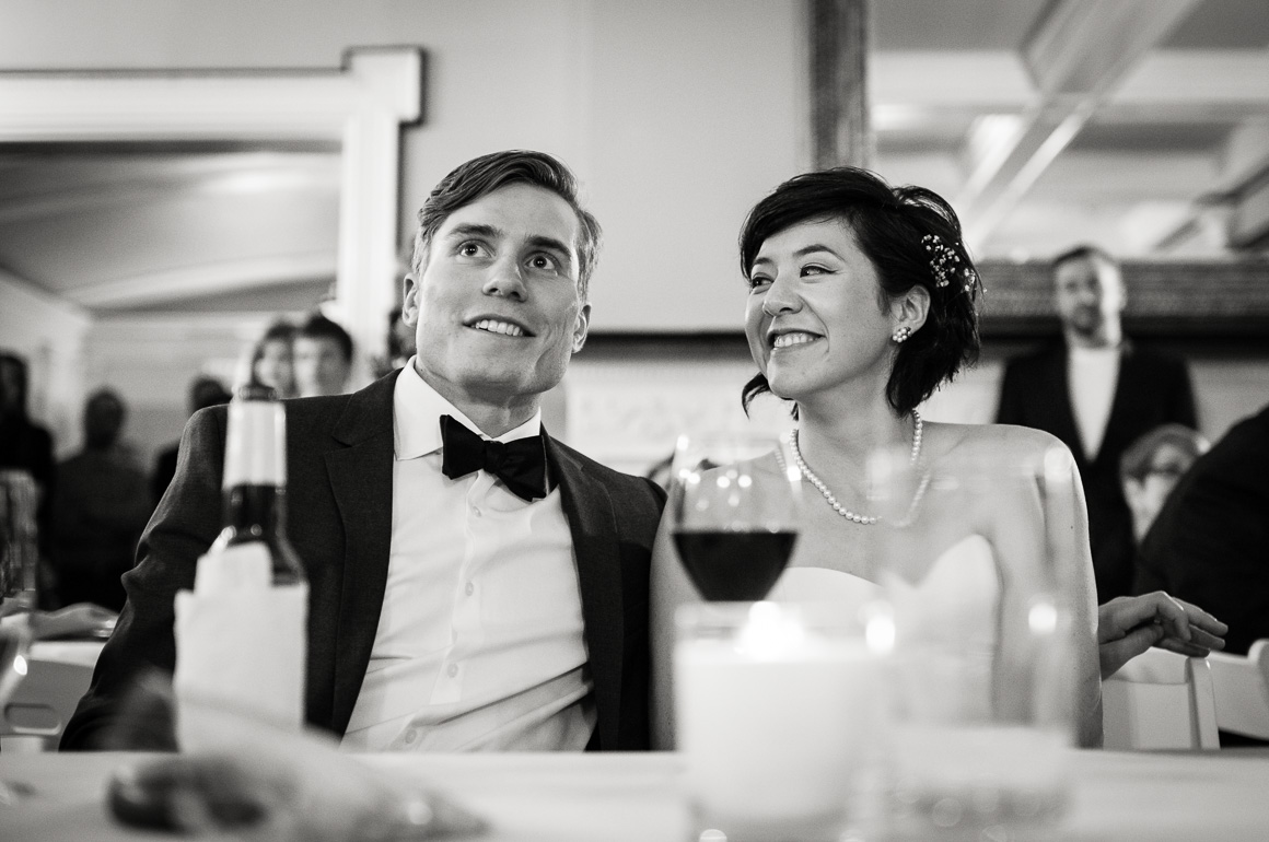 Newlyweds Listening to Toast assorted moments Denver wedding photojournalist