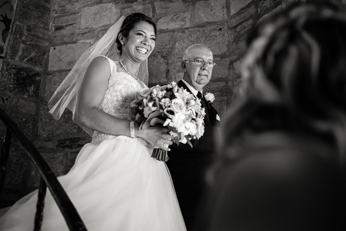 bride father spiral staircase Denver wedding photojournalist