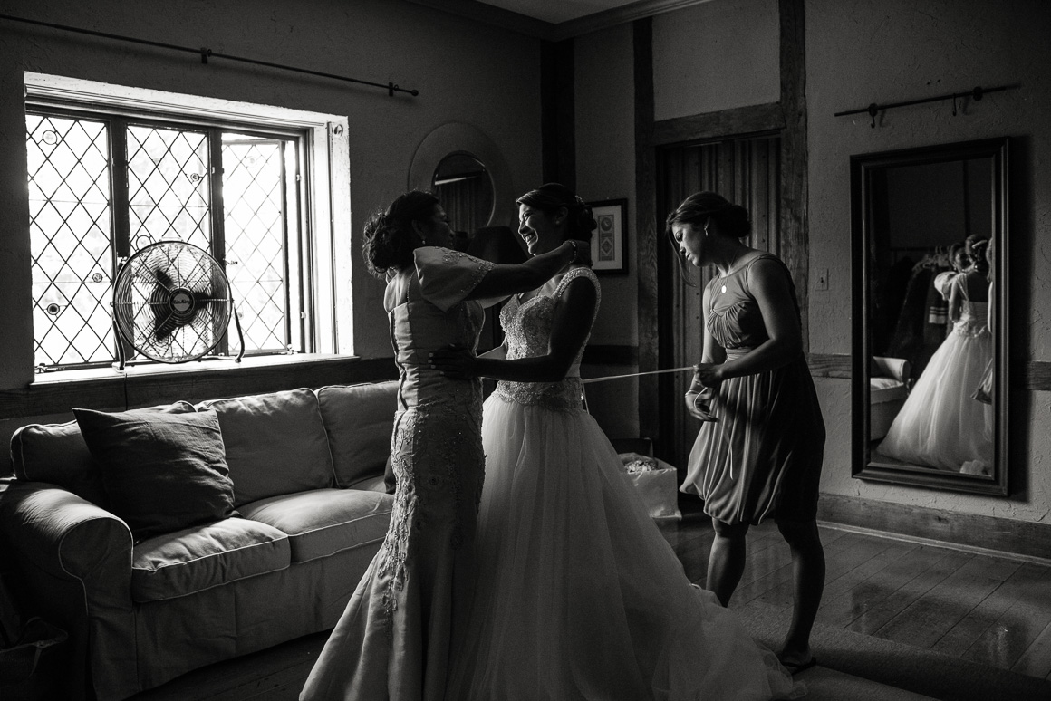 cloisters castle wedding bride hug Stephanie Darrin Denver wedding photojournalist