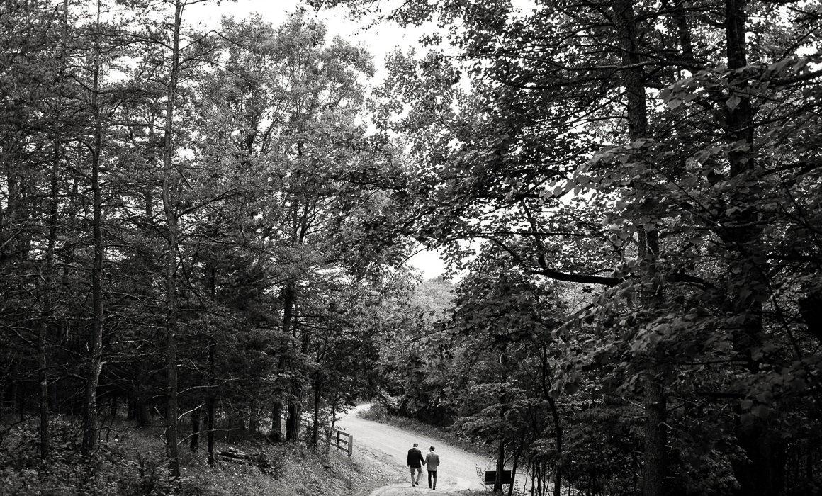 West Virginia wedding couple walk through woods