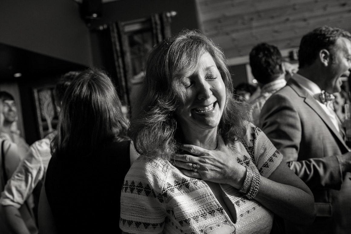 Woman laughing during West Virginia wedding reception.