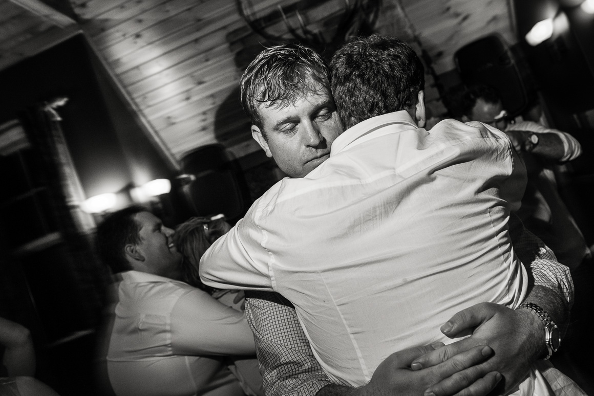 Grooms hug at Lost River, West Virginia wedding reception.