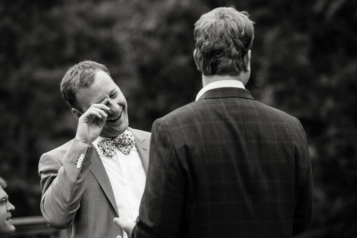 Groom wipes away tear during West Virginia wedding ceremony.