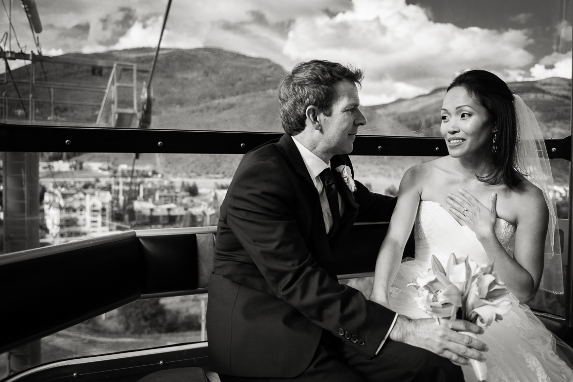 vail mountain colorado newlyweds sitting candid wedding photographer