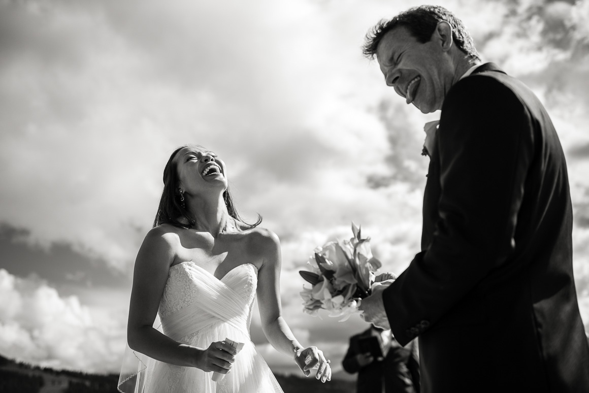 vail wedding photojournalist mountain newlyweds laughing sky candid