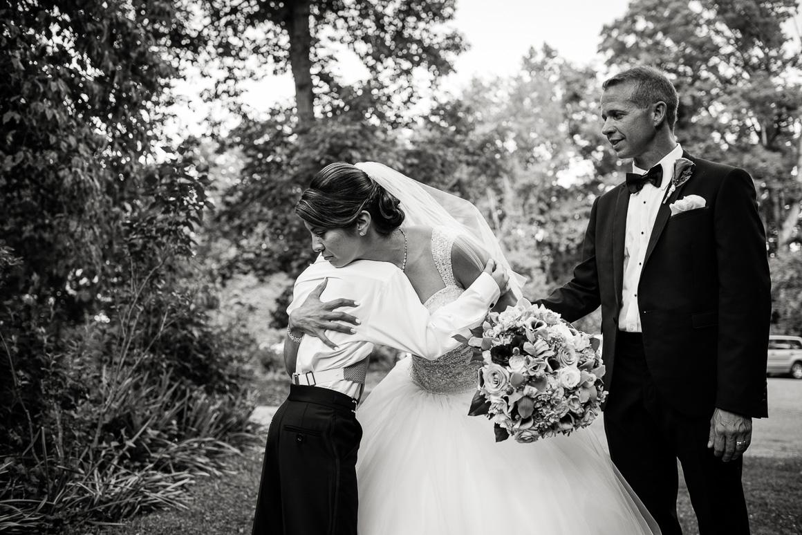 mother son hug wedding Colorado wedding photojournalist
