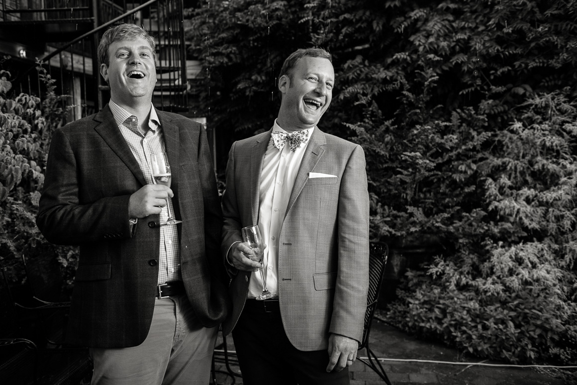 West Virginia wedding couple during champaign toast by Denver wedding photographer.