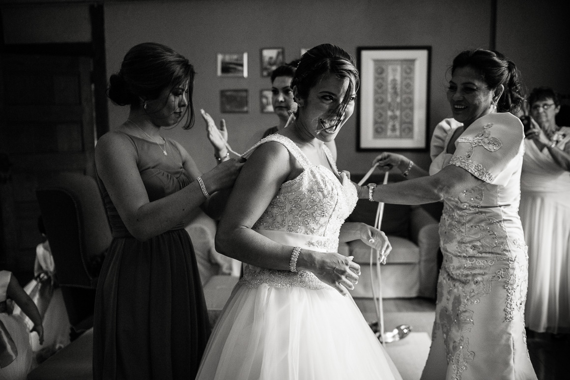 bride bridesmaids candid gown Stephanie Darrin Denver wedding photojournalist