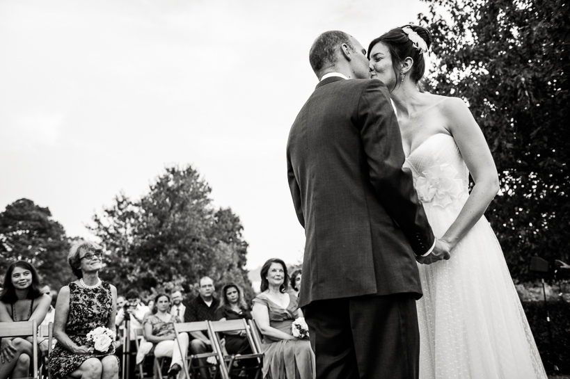 Ceremony kiss by Denver wedding photographer