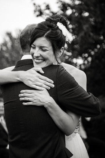 Bride embrace by Denver wedding photographer Carl Bower