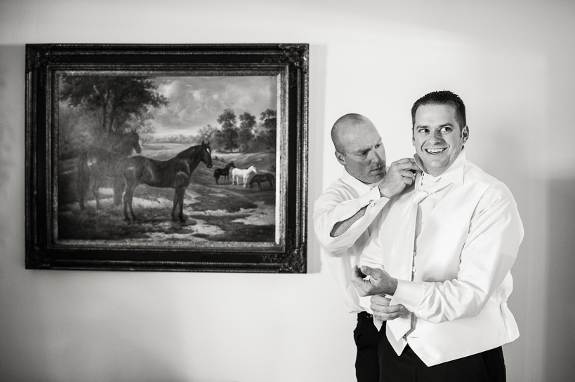 Groom getting ready by Denver wedding photographer
