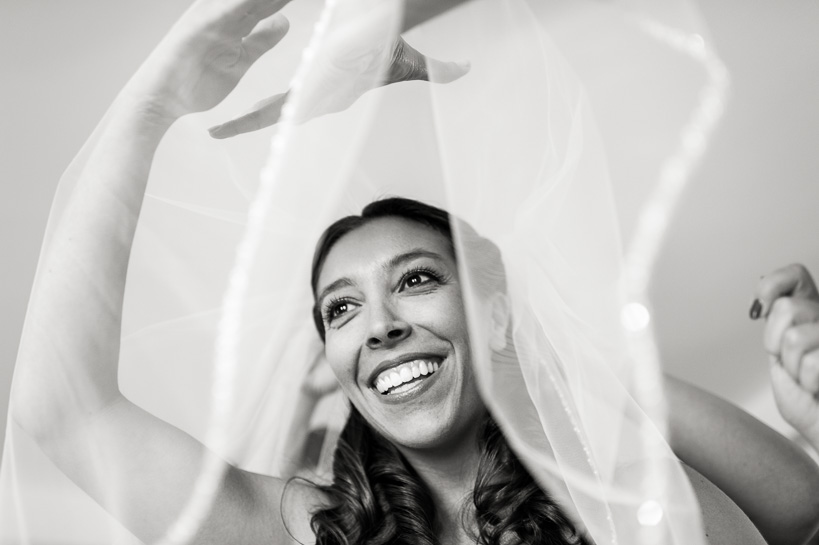 Bride getting ready by Denver wedding photographer