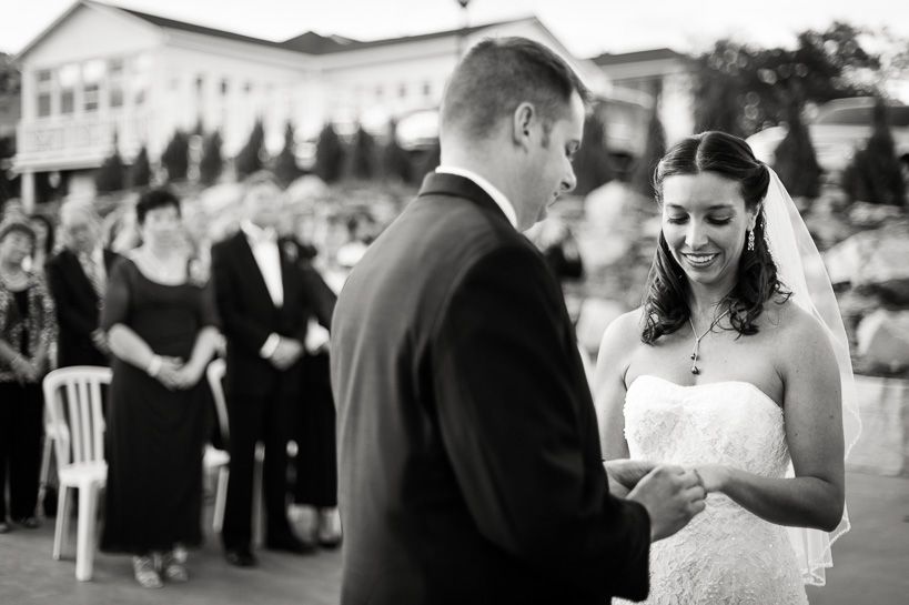Exchanging rings at Morrison Colorado wedding by Denver wedding photojournalist