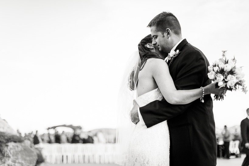 Bride and groom embrace following ceremony by Denver wedding photographer
