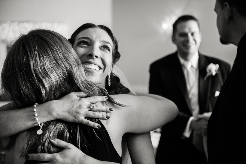Denver bride embraces friend at Willow Ridge Manor