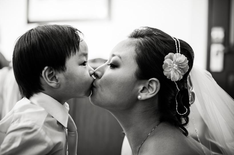 denver bride kisses boy