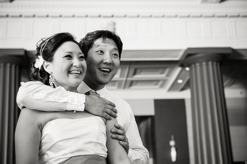 Bride and groom at reception by Denver wedding photographer.