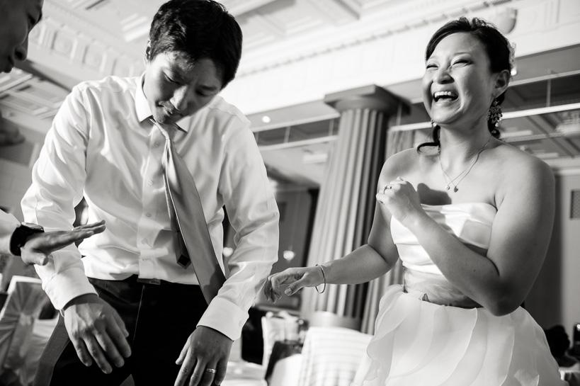 Bride and groom on dance floor by Denver wedding photographer.