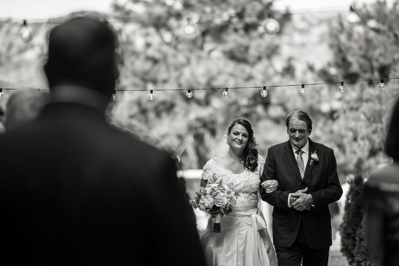 Bride and father walk down aisle in Colorado wedding