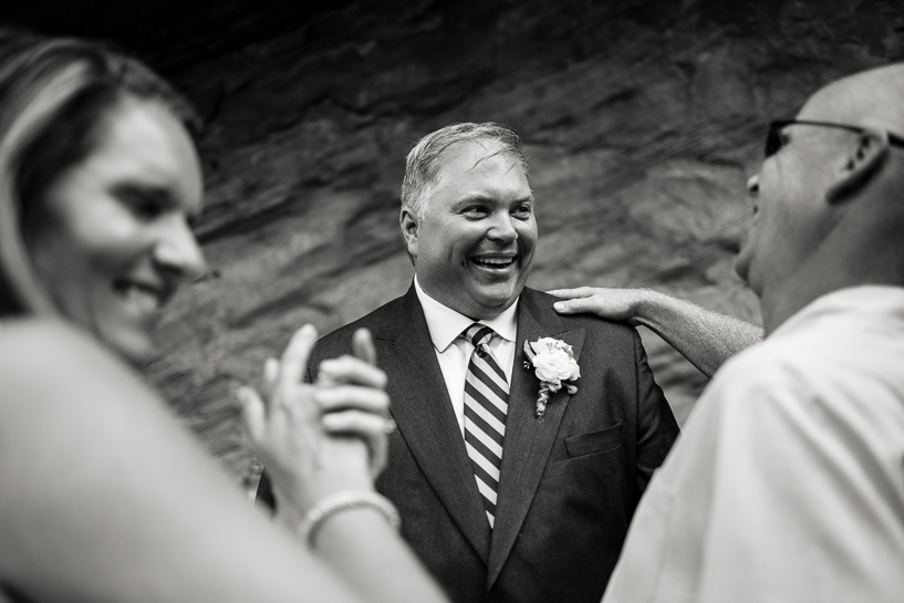 friends congratulate groom by denver wedding photographer