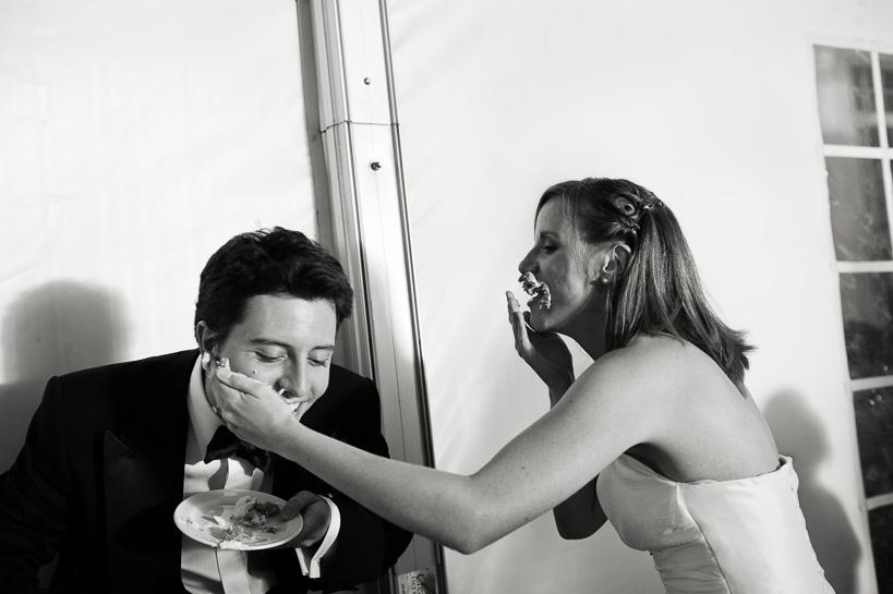 Denver wedding photojournalist captures wedding cake smashing.