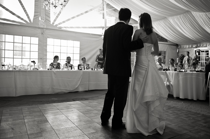Bride and groom during toasts at Morrison wedding by Denver wedding photojournalist.