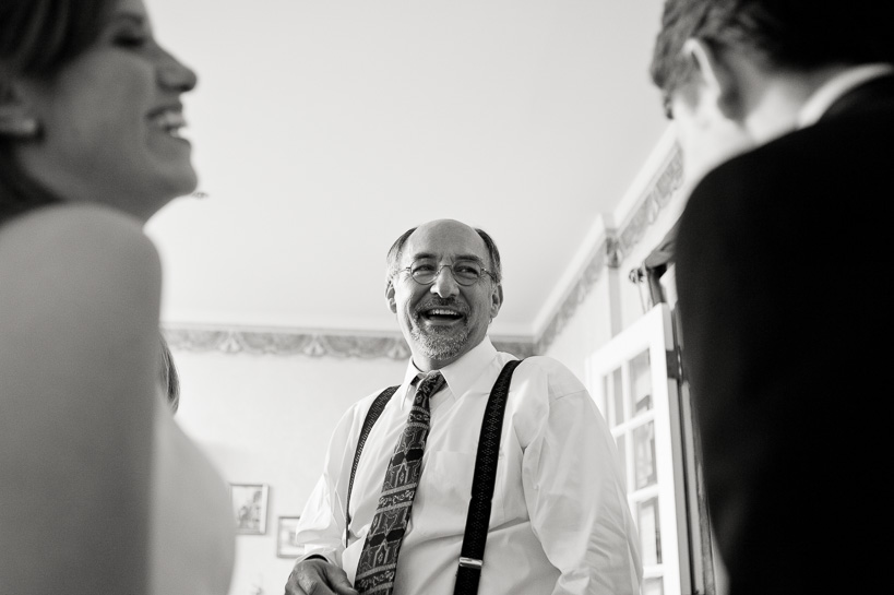 Laughing at Manor House wedding by Denver wedding photographer.