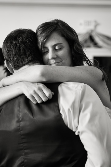 Denver photographer captures bride embracing groom at end of wedding reception.