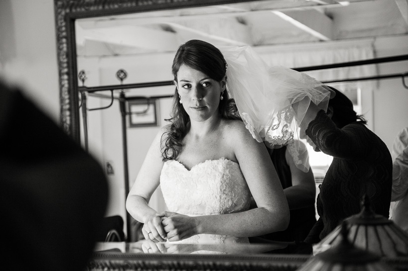 Bride quietly preparing for wedding at Virginia country home.