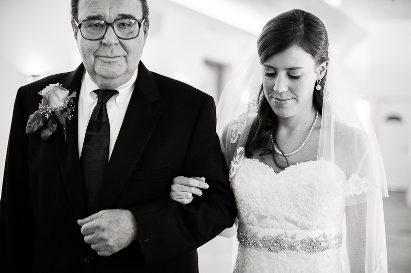Bride and sad father before ceremony by Denver wedding photographer Carl Bower