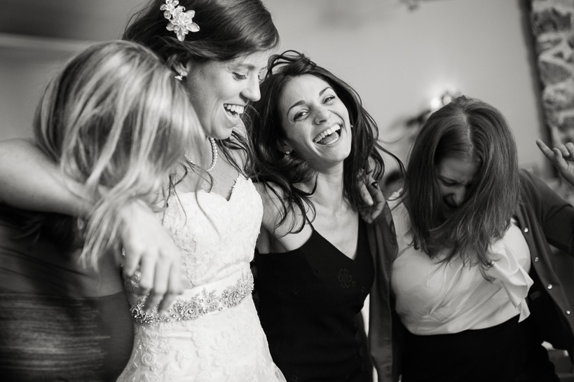Colorado wedding photographer records bride and friends dancing during reception.