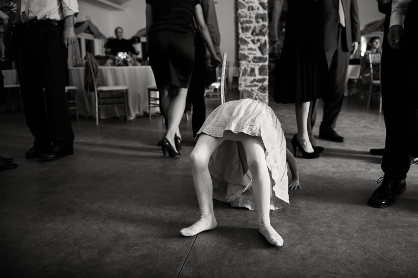 Girl does yoga at Virginia wedding.