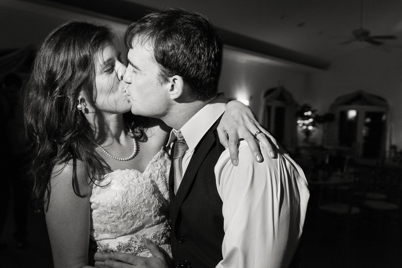 Bride and groom kiss at the end of a wedding reception in Northern Virginia.