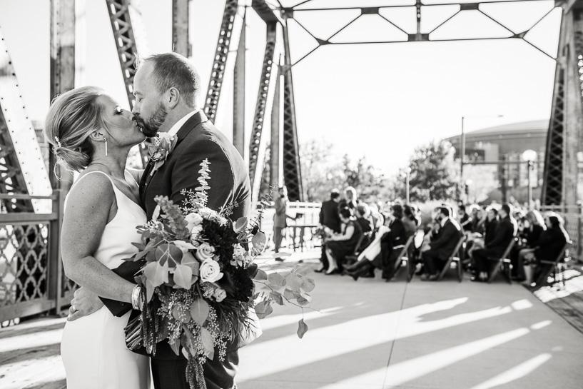Denver wedding photojournalist captures kiss after the ceremony.