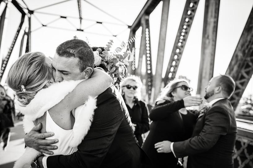 Hugging after wedding ceremony at Coohills restaurant.