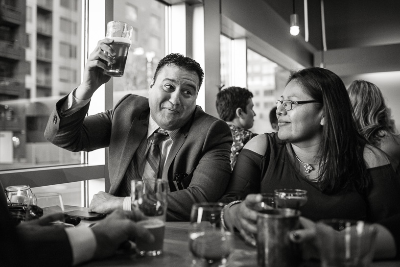 Raising a pint at Denver wedding reception.