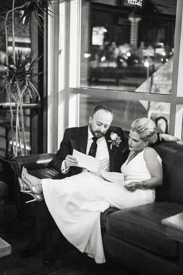 Bride and groom work on their speeches during Denver wedding reception.