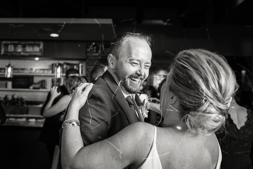 Denver wedding photojournalist shows couple dancing at Coohills.