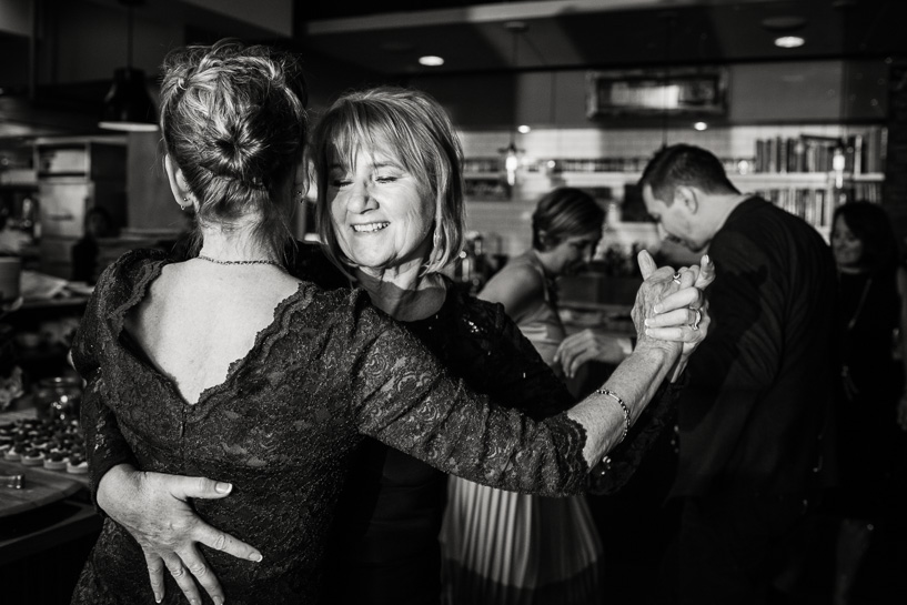 Denver wedding photographer captures mother of bride and groom dancing.