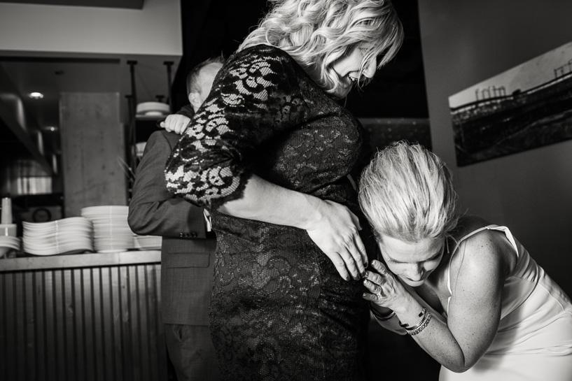Denver bride listens for kicking inside her friend's belly