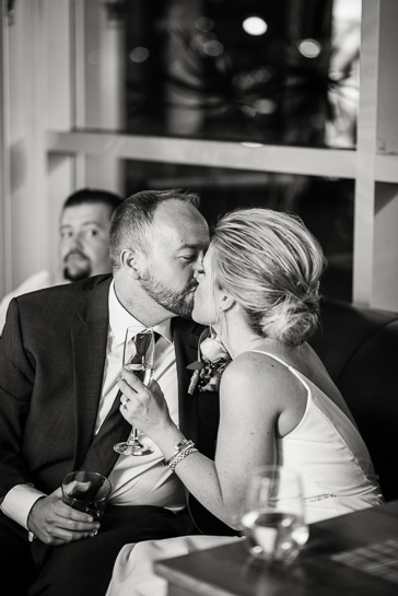 Couple kiss at Coohills wedding reception by Denver wedding photojournalist