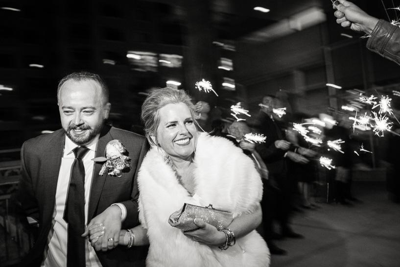 Denver wedding photojournalist captures couple leaving Coohills wedding