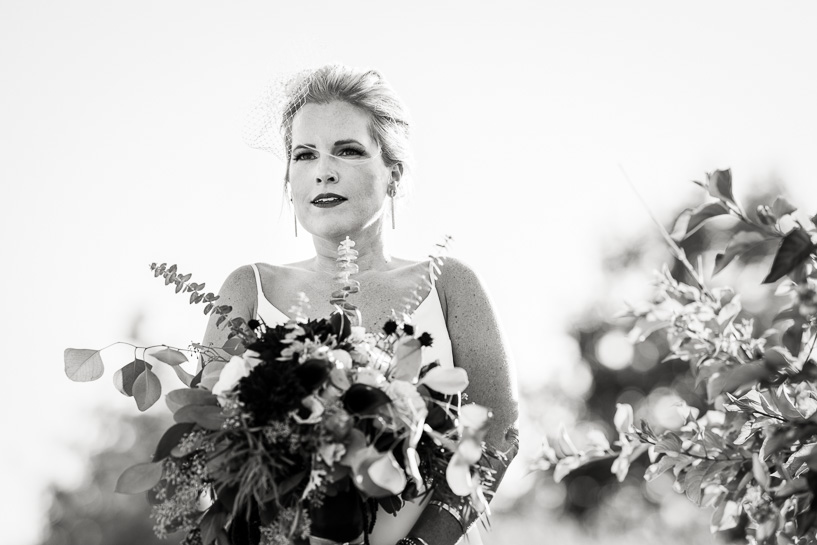 Bride awaits her cue by Denver wedding photojournalist.
