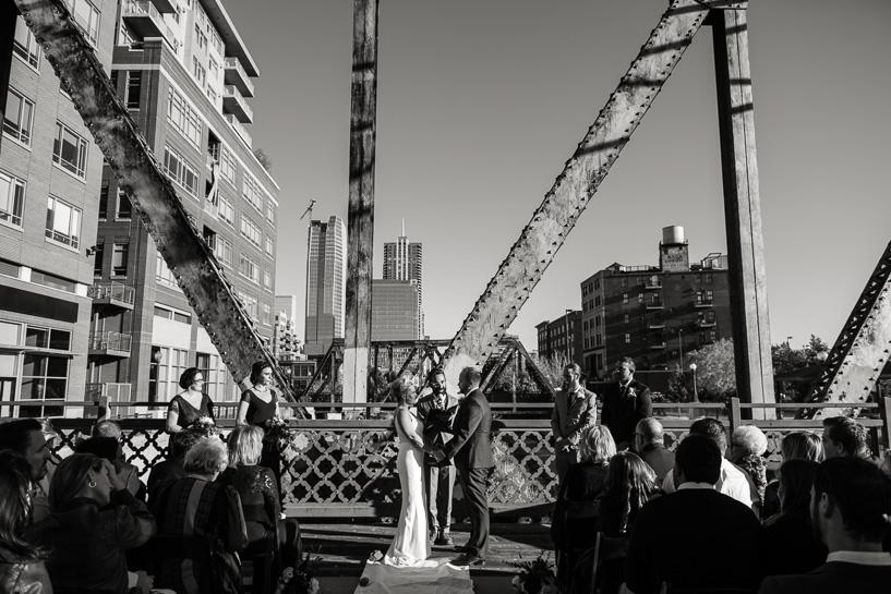 Downtown Denver wedding ceremony on bridge over Cherry Creek.