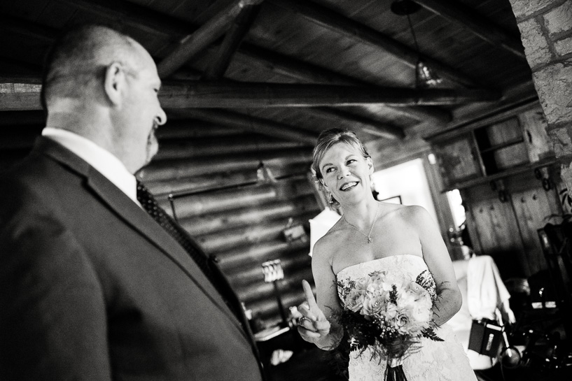 Bride with officiant before backyard wedding ceremony.